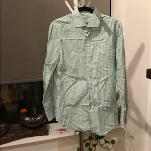 Green button down. Used